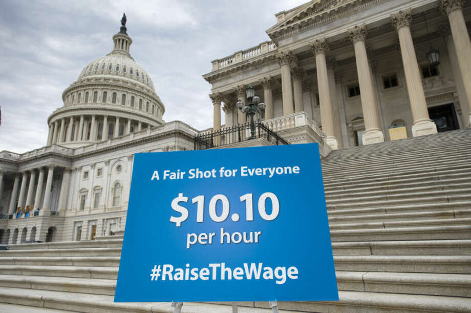 FILE - In this April 2, 2014, file photo, a chart prepared by Senate Democrats rests on an easel on the Senate steps before a news conference urging approval for raising the minimum wage, at the Capitol in Washington. Win or lose, and they'll probably lose, Democrats hope this week's Senate showdown over raising the federal minimum wage reaps them benefits in November's congressional elections. (AP Photo/J. Scott Applewhite)