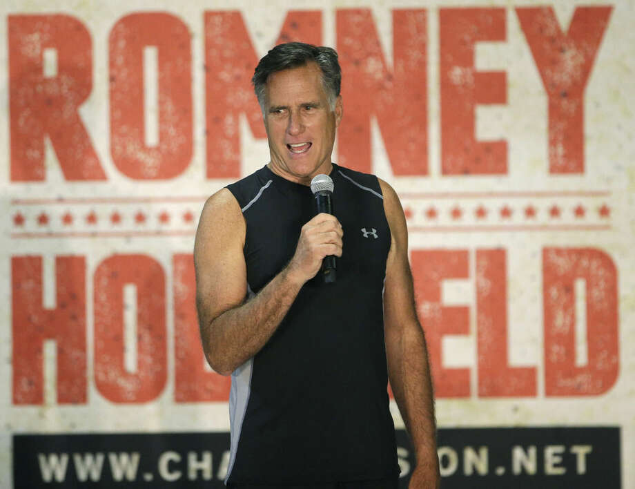 Former Republican presidential candidate Mitt Romney speaks during an official weigh-in with five-time heavyweight boxing champion Evander Holyfield, Thursday, May 14, 2015, in Holladay, Utah. Romney and Holyfield are set to square off at a charity fight on Friday, May 15, in Salt Lake City. The black-tie event will raise money for the Utah-based organization CharityVision, which helps doctors in developing countries perform surgeries to restore vision in people with curable blindness. (AP Photo/Rick Bowmer)