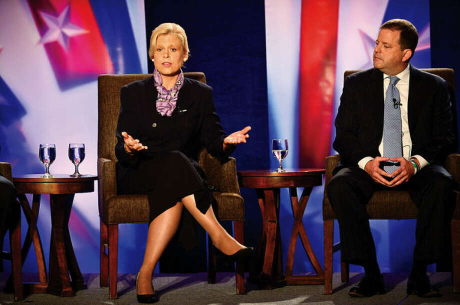 Hour photo / Erik Trautmann Republican gubernatorial candidates; Avon attorney Martha Dean and State Sen. John McKinney participate in The Business Council of Fairfield County GOP pre-convention debate at the Stamford Sheraton Wednesday morning.