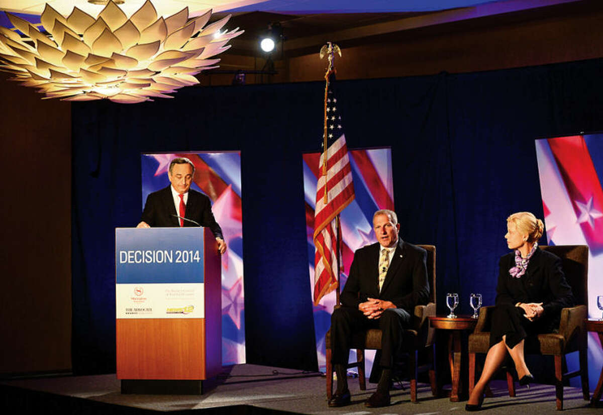 Hour photo / Erik Trautmann News 12 News Director Tom Appleby moderates the Republican gubernatorial candidates; Shelton mayor Mark Laurettis and Avon attorney Martha Dean as they participate with other candiadtes in The Business Council of Fairfield County GOP pre-convention debate at the Stamford Sheraton Wednesday morning.