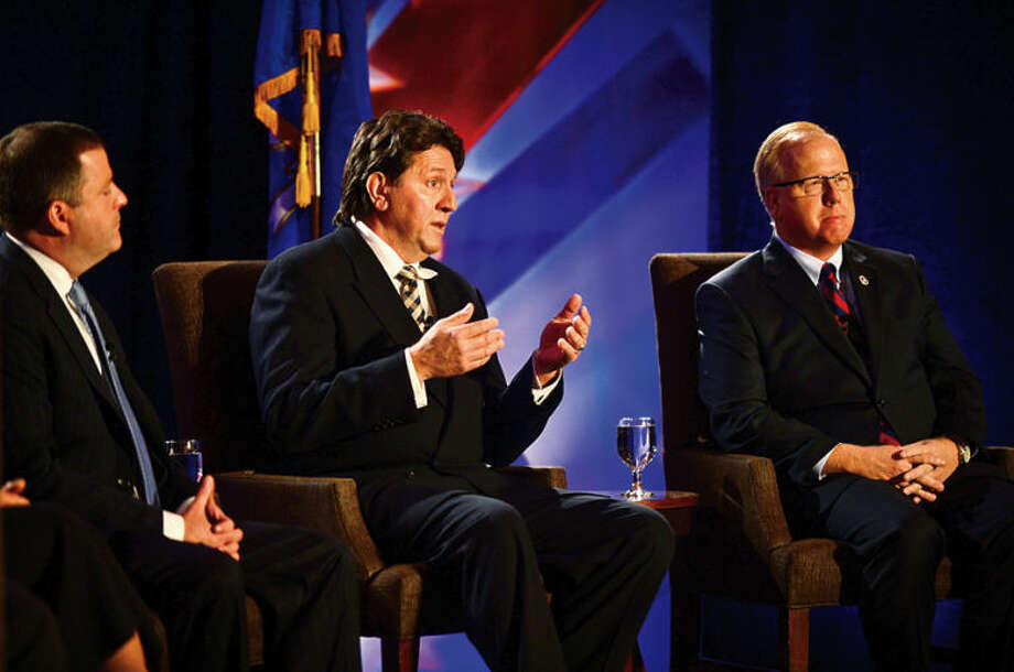 Hour photo / Erik Trautmann Republican gubernatorial candidates; State Sen. John McKinney, West Hartford Town Councilman Joe Visconti and Danbury mayor Mark Boughton participate in The Business Council of Fairfield County GOP pre-convention debate at the Stamford Sheraton Wednesday morning.