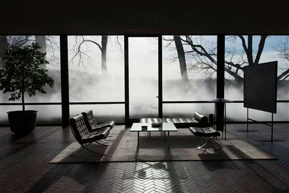 "This Saturday, April 19, 2014 photo provided by courtesy of The Glass House shows, artist Fujiko Nakaya's first fog installation on the east coast in 30 years, which can be viewed from inside or outside the Modernist Glass House it surrounds. Like the glass structure itself, ""Fujiko Nakaya: Veil"" plays on the visible and invisible, transparent and opaque, permanent and ephemeral. The installation, about an hour's train ride north of New York City, is open to the public from May 1 to November 30, 2014. / Courtesy The Glass House"