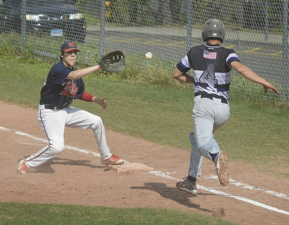 Hour photo/Alex von KleydorffBrien McMahon's Matthew Galyas, left, gets the throw at first base for the out before Westhill's Luke Dawson can reach the bag during Friday's game in Stamford.