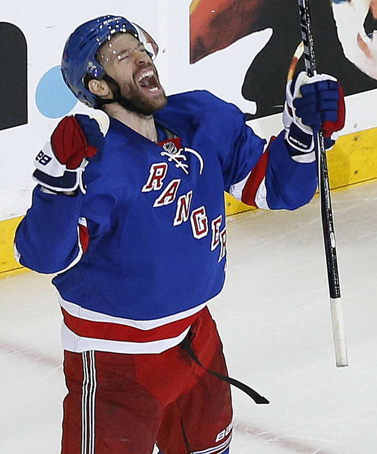 New York Rangers center Dominic Moore celebrates after scoring the game-winning goal against the Tampa Bay Lightning during the third period of Game 1 of the Eastern Conference final during the NHL hockey Stanley Cup playoffs, Saturday, May 16, 2015, in New York. The Rangers won 2-1. (AP Photo/Julie Jacobson)