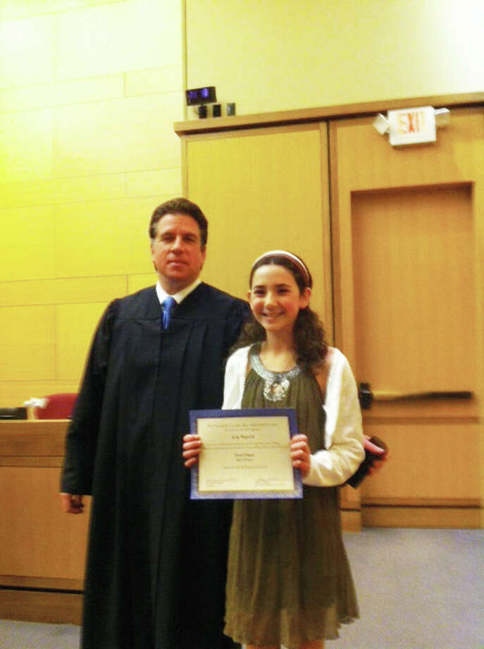 Middlebrook School sixth-grader Lily Meyers pictured with Superior Court Judge Thomas D. Colin.