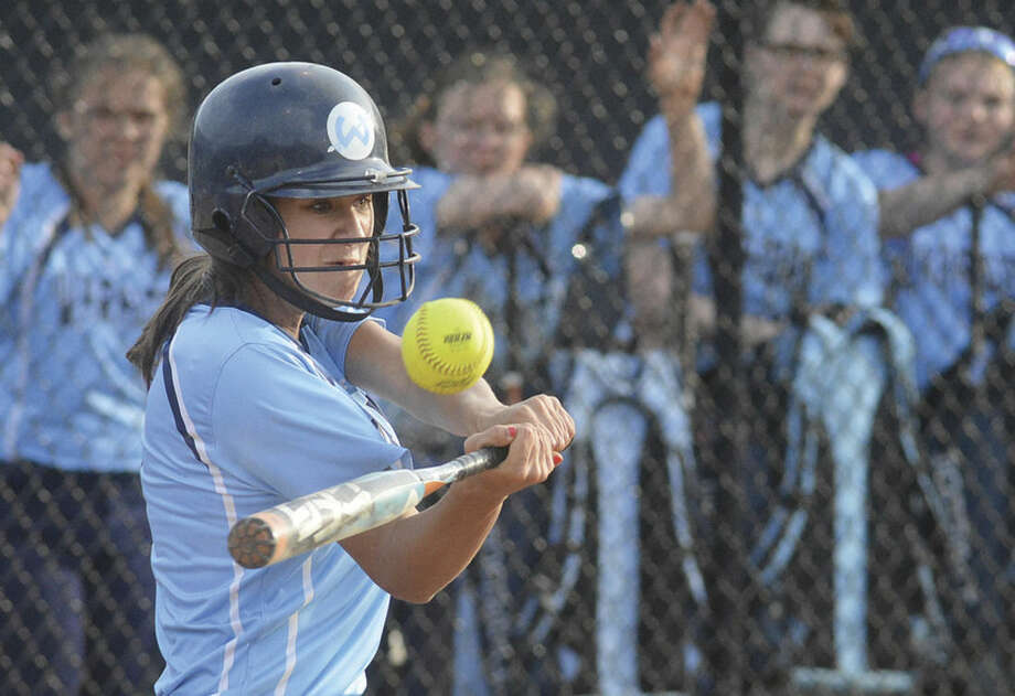 Hour photo/Alex von KleydorffWilton's Julia Schiavone swings at a pitch during Friday's game vs. Norwalk.