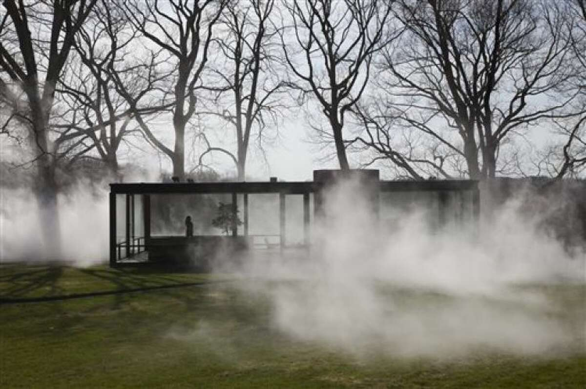 """This Saturday, April 19, 2014 photo provided by courtesy of The Glass House shows Tokyo-based artist, Fujiko Nakaya's latest """"fog installation,"""" meant to conceal the visible while accentuating usually invisible forces like wind. Like the glass structure itself, """"Fujiko Nakaya: Veil"""" plays on the visible and invisible, transparent and opaque, permanent and ephemeral. The installation, about an hour's train ride north of New York City, is open to the public from May 1 to November 30, 2014."""