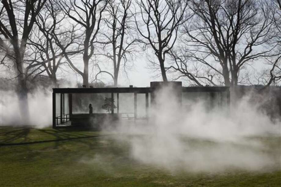"This Saturday, April 19, 2014 photo provided by courtesy of The Glass House shows Tokyo-based artist, Fujiko Nakaya's latest ""fog installation,"" meant to conceal the visible while accentuating usually invisible forces like wind. Like the glass structure itself, ""Fujiko Nakaya: Veil"" plays on the visible and invisible, transparent and opaque, permanent and ephemeral. The installation, about an hour's train ride north of New York City, is open to the public from May 1 to November 30, 2014."