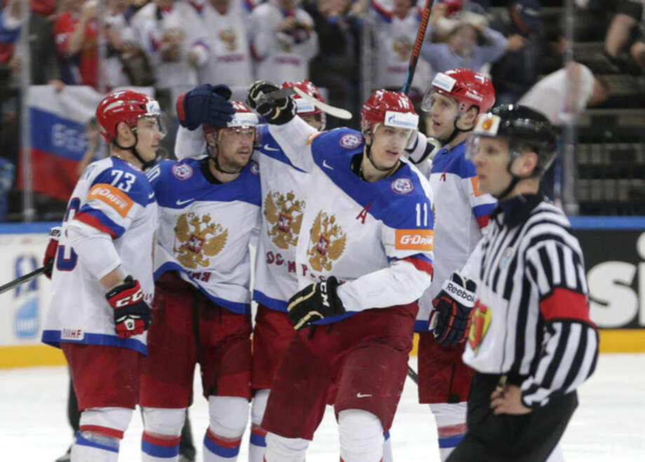 Russian players celebrate after opening the score against the United States during the Hockey World Championships semifinal match in Prague, Czech Republic, Saturday, May 16, 2015. (AP Photo/Petr David Josek)