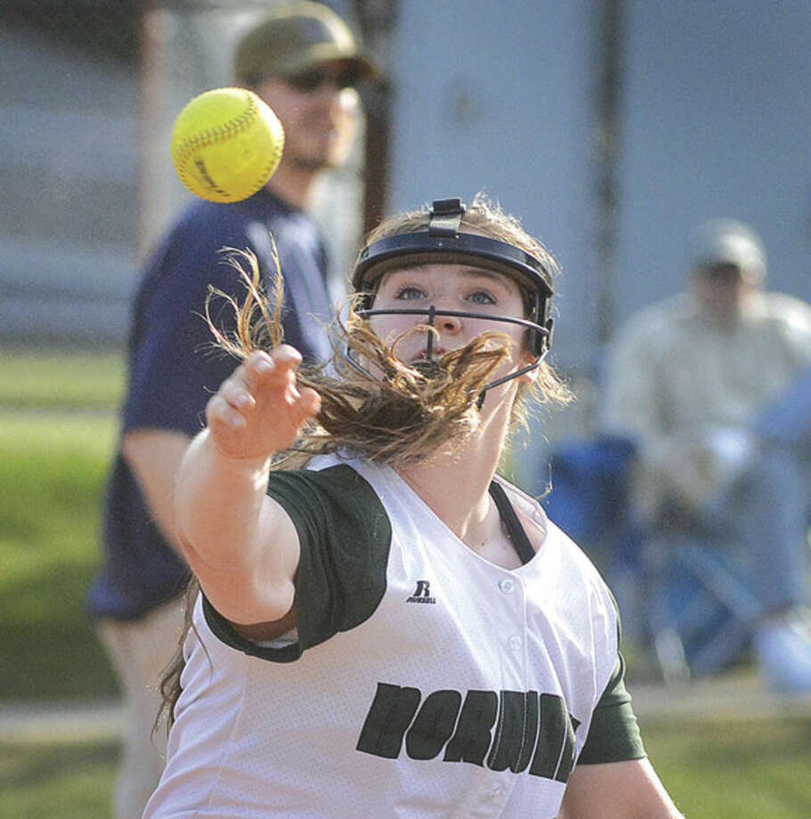 Hour photo/Alex von KleydorffNorwalk's Dina DiBlasio throws to first for the out versus Wilton on Friday night in Wilton.