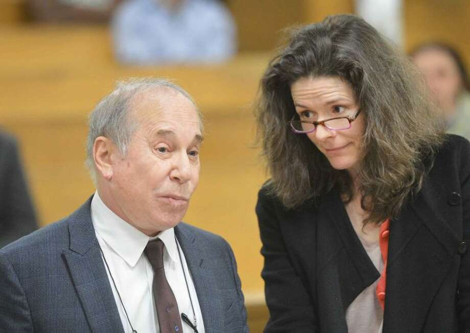 Hour Photo/Alex von Kleydorff.Paul Simon and Edie Brickell in Norwalk Superior Court on Monday April 28th. Famed singer Paul Simon and his musician wife Edie Brickell have been arrested on a misdemeanor domestic violence charge. New Canaan Police arrested Simon, 72, and Brickell, 47, on Saturday at approximately 8:20 p.m. Both Simon and Brickell were each charged with disorderly conduct for a disturbance at their New Canaan home.