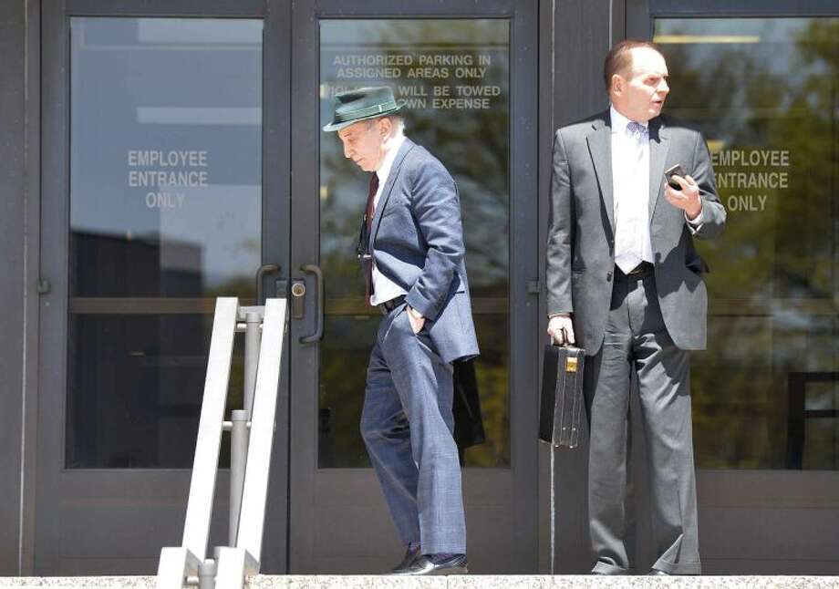 Hour Photo/Alex von Kleydorff.Paul Simon, left, leaves the back exit at Norwalk Superior Court with his attorney Stephen Hayes on Monday April 28th. Famed singer Paul Simon and his musician wife Edie Brickell have been arrested on a misdemeanor domestic violence charge. New Canaan Police arrested Simon, 72, and Brickell, 47, on Saturday at approximately 8:20 p.m. Both Simon and Brickell were each charged with disorderly conduct for a disturbance at their New Canaan home.