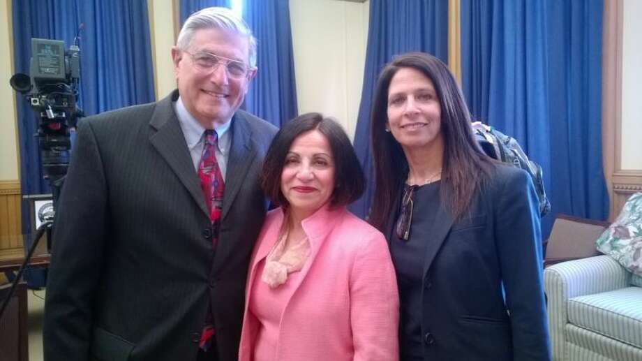 Financial advisor John Sayour, state Sen. Toni Boucher and financial planner Hope Feller hold a press conference in Hartford regarding a state-run retirement proposal.