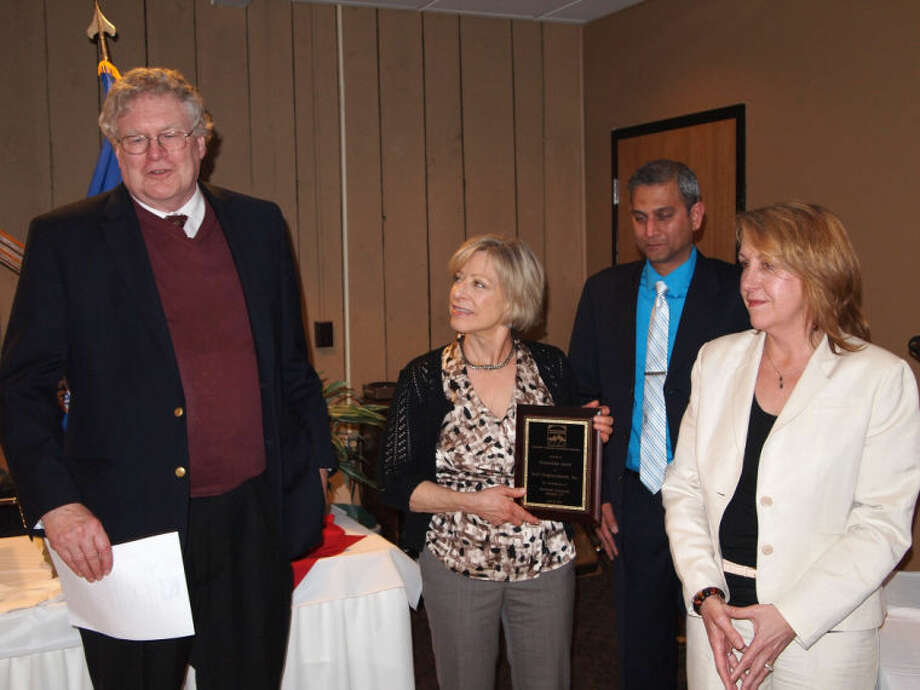 Pictured from left to right are; Ross Burkhardt, president and CEO of New Neighborhoods, Inc.; Cathleen Miller, construction manager of New Neighborhoods, Inc.; Dimple Desai, board director of the CT Community Development Association; and Kathy Hunter, president of the CT Community Development Association.