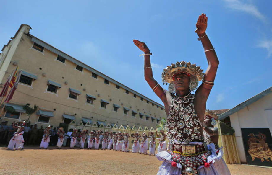 Sri Lankan prisoners perform their maiden traditional Kandyan dance at the main jail in Colombo, Sri Lanka, Wednesday, April 30, 2014. The program is part of leisure and recreational programs for prisoners aimed at rehabilitating them. Sri Lanka's prison facilities run various industries and offers opportunities for arts, education and religious activities for the prisoners. (AP Photo/Eranga Jayawardena)