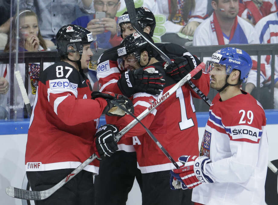 Canada's players celebrate their goal against Czech Republic during the Hockey World Championships semifinal match in Prague, Czech Republic, Saturday, May 16, 2015. (AP Photo/Sergei Grits)