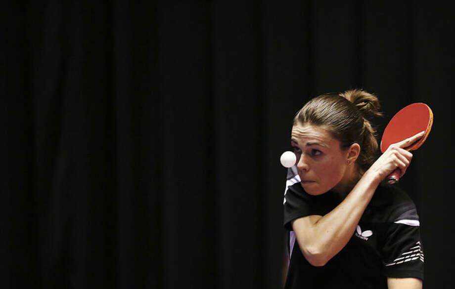 Eva Odorova of Slovakia watches the ball during her round robin match of the World Team Table Tennis Championships against Katarzyna Grzybowska of Poland in Tokyo, Wednesday, April 30, 2014. (AP Photo/Eugene Hoshiko)