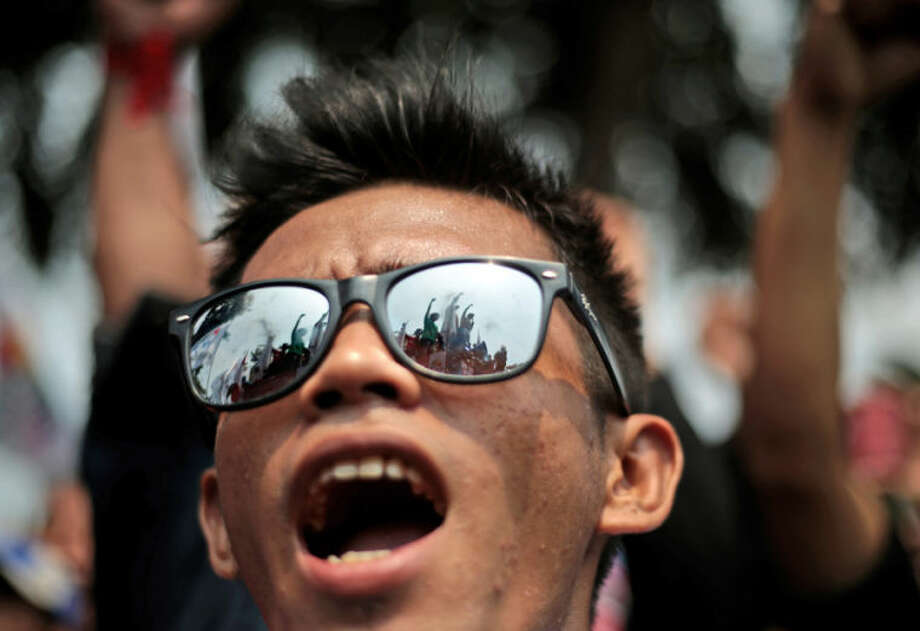 A worker shout slogans during a May Day rally outside the presidential palace in Jakarta, Indonesia, Thursday, May 1, 2014. (AP Photo/Dita Alangkara)