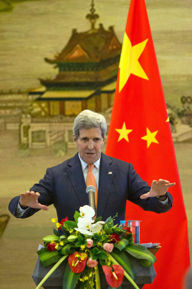 U.S. Secretary of State John Kerry attends a joint press conference with Chinese Foreign Minister Wang Yi, unseen following meetings at the Ministry of Foreign Affairs in Beijing Saturday, May 16, 2015. U.S. Secretary of State Kerry is urging China to halt increasingly assertive actions it is taking in the South China Sea. (AP Photo/Ng Han Guan, Pool)