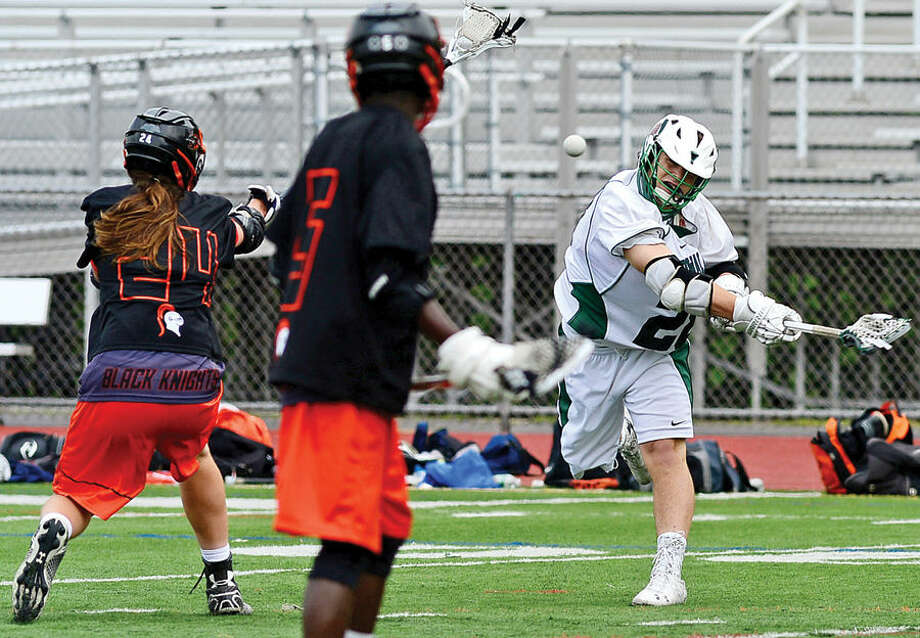 Hour photo / Erik Trautmann Norwalk's # 28 Joseph Laracca takes a shot on goal as Norwalk High School lacrosse battles Stamford High School in their game at Testa Field Saturday