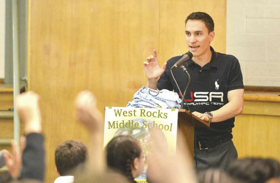 "Paralympian Tyler Carter asks Sixth graders how many have been to a party where alcohol was present during The Foundation for Advancing Alcohol Responsibility program at West Rock Middle School. Ask Listen Learn educates students on the dangers of underage drinking by saying ""yes"" to a healthy lifestyle and ""no"" to underage drinking, in Norwalk conn. May 9 2016"