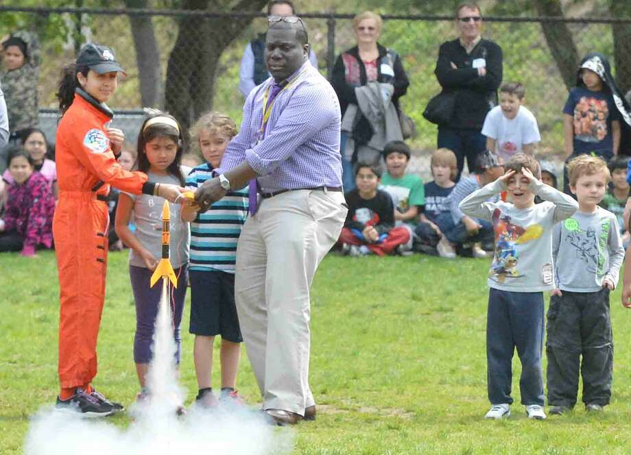 Columbus Magnet School Young Astronauts launch a dozen rockets to commemorate the Space Shuttle Challenger and its crew