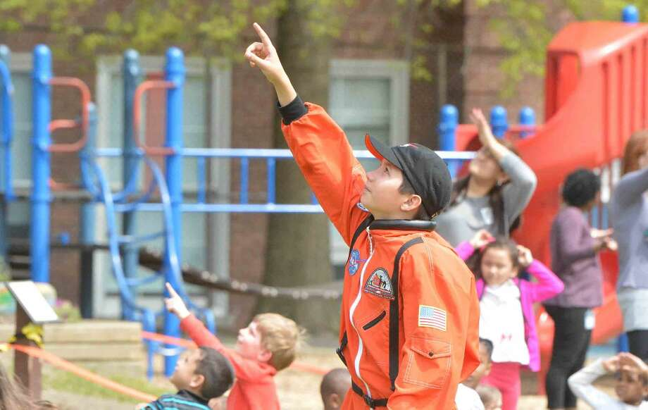 The recovery crew looks for rockets during Columbus Magnet School Young Astronauts launch of a dozen rockets to commemorate the Space Shuttle Challenger and its crew