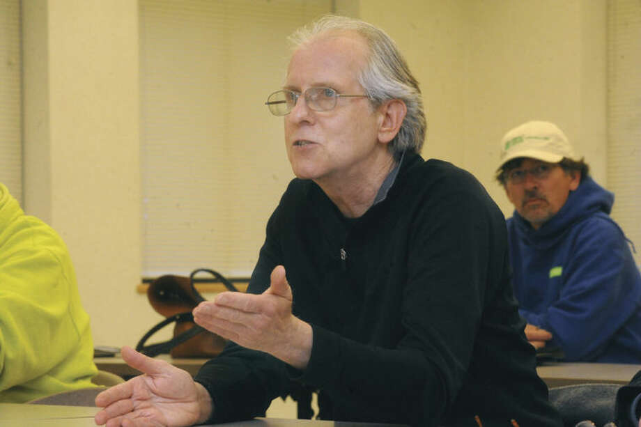Above, Patrick Vingo of Norwalk talks about his concerns with paving and sidewalks in the Taylor Avenue portion of Norwalk Tuesday night at the Mayor's Night Out held in the Norwalk Police Department Community Room. At right, Marcus Hargrave speaks about police procedures.