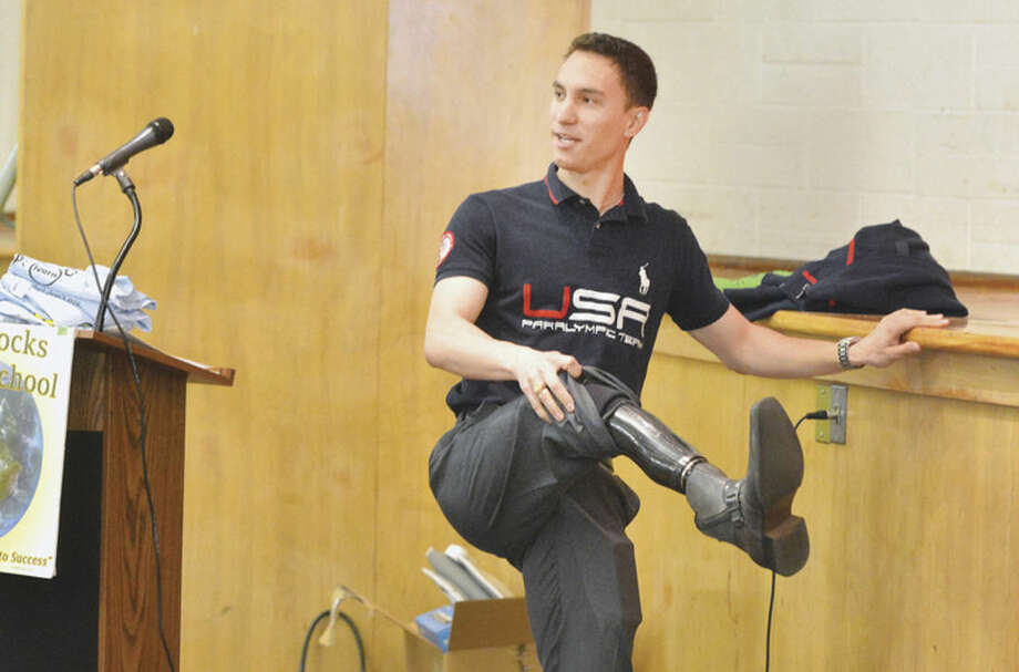 "Paralympian Tyler Carter shows his Prosthetic leg during The Foundation for Advancing Alcohol Responsibility program at West Rock Middle School. Ask Listen Learn educates students on the dangers of underage drinking by saying ""yes"" to a healthy lifestyle and ""no"" to underage drinking, in Norwalk conn. May 9 2016"
