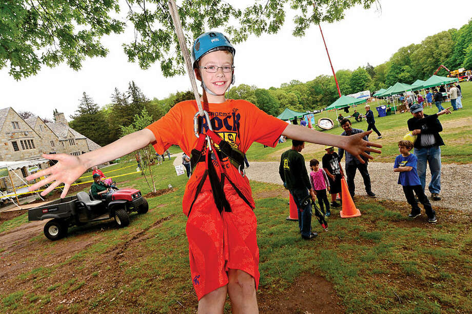 Hour photo / Erik Trautmann 10 year old Ryan Ballard gets lifted up into a tree during the Norwalk Tree Alliance's 8th annul Tree Fest Saturday at Cranbury Park.
