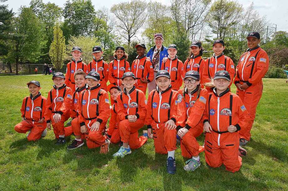 Crew photo of Columbus Magnet School Young Astronauts after they commemorate the Space Shuttle Challenger and its crew by launching a dozen rockets