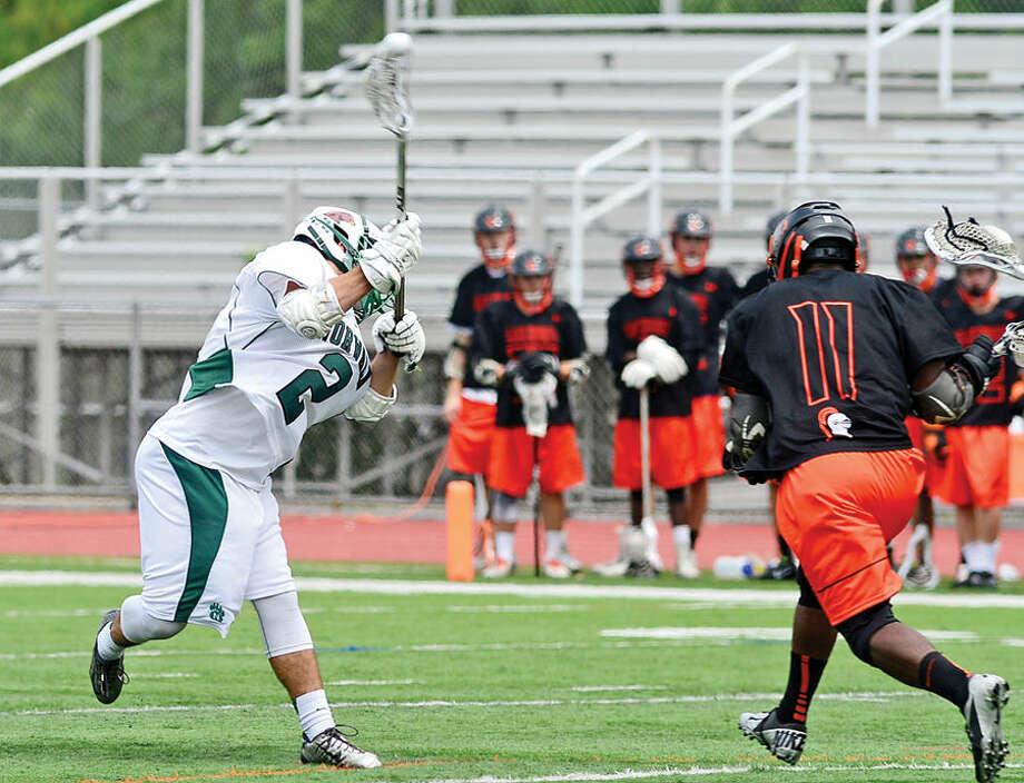 Hour photo / Erik Trautmann Norwalk High School lacrosse battles Stamford High School in their game at Testa Field Saturday