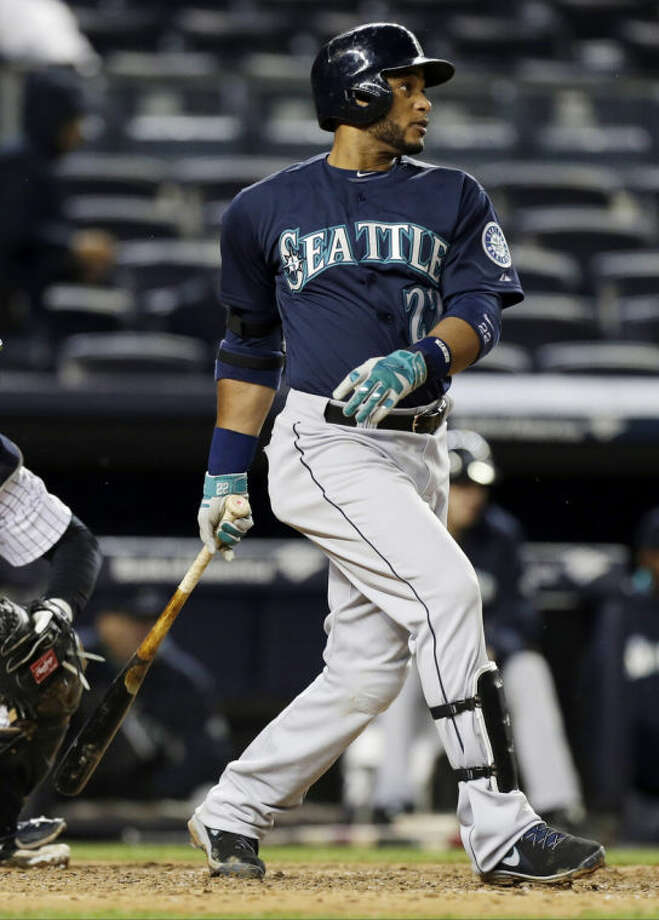 Seattle Mariners' Robinson Cano follows through on a single during the seventh inning of a baseball game against the New York Yankees, Tuesday, April 29, 2014, in New York. (AP Photo)