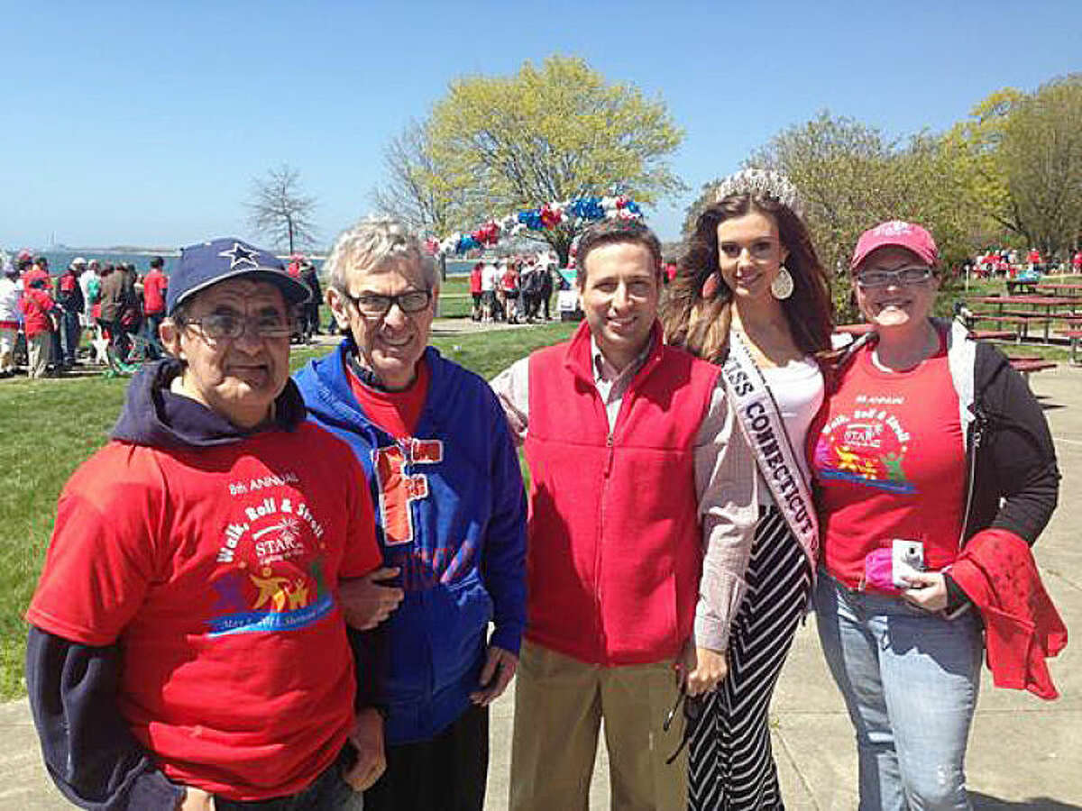 Contributed photo Senator Bob Duff with Miss CT Erin Brady (who was crowned Miss USA the same year) and STAR friends at the walk in 2013.