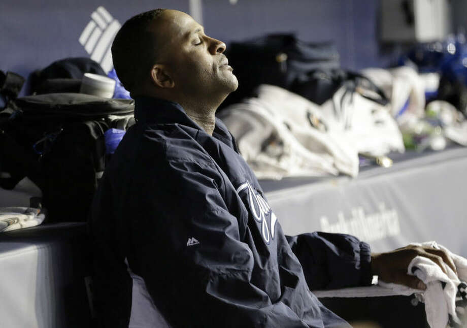 New York Yankees starting pitcher CC Sabathia sits after leaving a baseball game against the Seattle Mariners during the sixth inning Tuesday, April 29, 2014, in New York. (AP Photo)