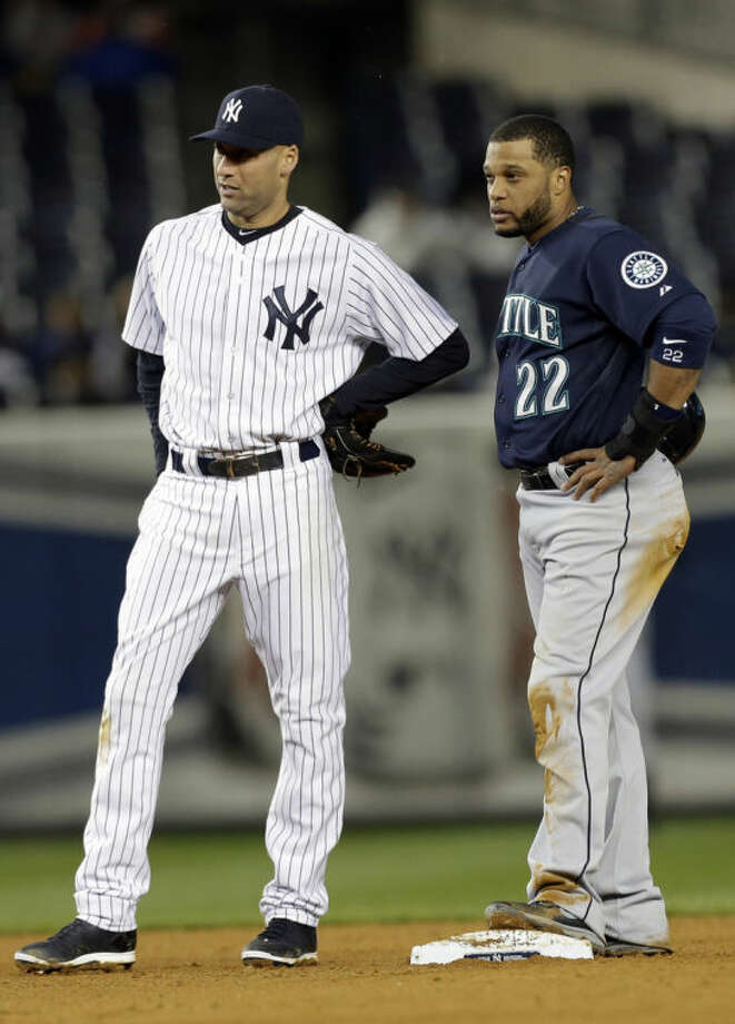 Seattle Mariners' Robinson Cano, left, and New York Yankees' Derek Jeter, talk during the seventh inning of a baseball game Tuesday, April 29, 2014, in New York. (AP Photo)