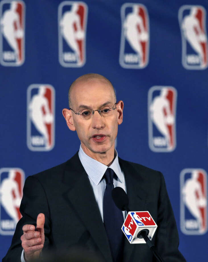 NBA Commissioner Adam Silver makes a statement during a news conference in New York, Tuesday, April 29, 2014. Silver announced that Los Angeles Clippers owner Donald Sterling has been banned for life by the league, in response to racist comments the league says he made in a recorded conversation. (AP Photo/Kathy Willens)