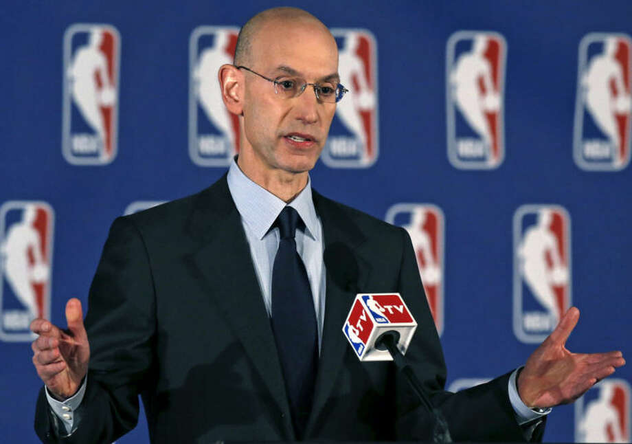NBA Commissioner Adam Silver addresses the media during a news conference in New York, Tuesday, April 29, 2014. Silver announced that Los Angeles Clippers owner Donald Sterling has been banned for life by the league in response to racist comments the league says he made in a recorded conversation. (AP Photo/Kathy Willens)