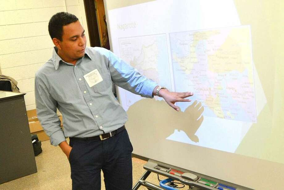 Hour Photo/Alex von Kleydorff Miguel Salinas, new Field Director for Norwalk Nagarote Sister City Project shows a map of Nicaragua during a presentation to a group of Norwalk High School students about the Build On Project