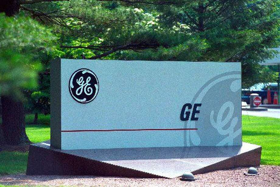 The entrance to GE Corporate headquarters is seen at 3135 Easton Turnpike in Fairfield. The company said Electric Co. said fourth-quarter profit fell 21 percent, its biggest quarterly decline in nine years, and forecast a first- quarter earnings decline of as much as 10 percent.