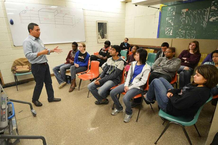 Hour Photo/Alex von Kleydorff Miguel Salinas, new Field director for Norwalk Nagarote Sister City Project speaks to a group of Norwalk High School students about the Build On Project