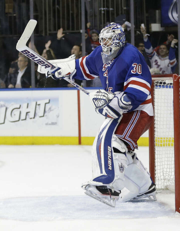 New York Rangers goalie Henrik Lundqvist (30), of Sweden, celebrates after Game 7 of an NHL hockey first-round playoff series against the Philadelphia Flyers, Wednesday, April 30, 2014, in New York. The Rangers won the game 2-1. (AP Photo)