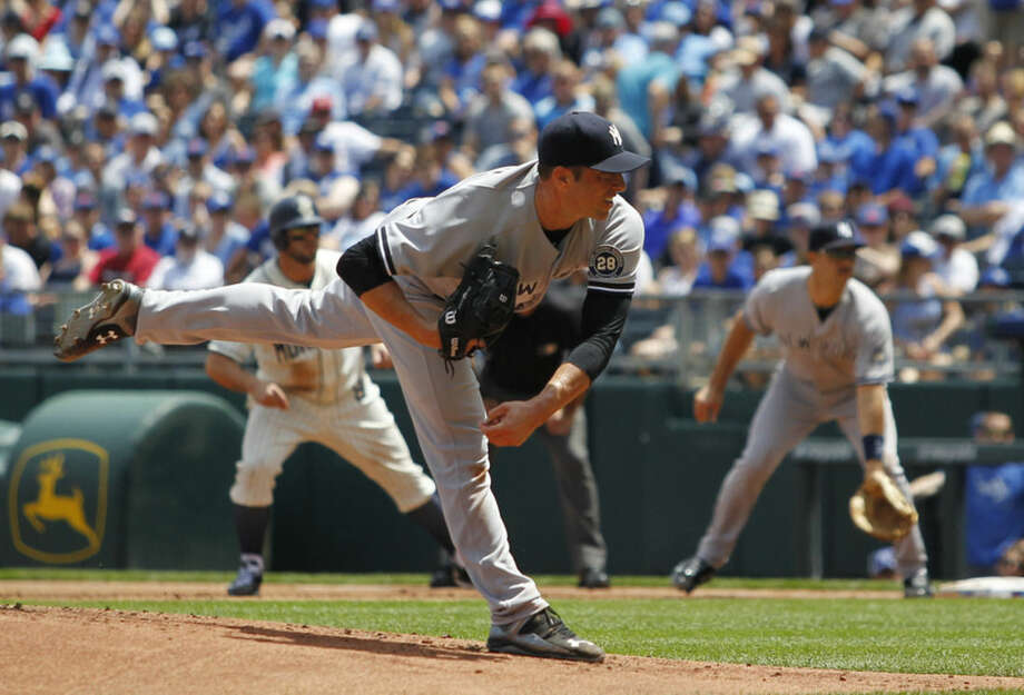 New York Yankees pitcher Chris Capuano delivers in the first inning of a baseball game against the Kansas City Royals in Kansas City, Mo., Sunday, May 17, 2015. (AP Photo/Colin E. Braley)