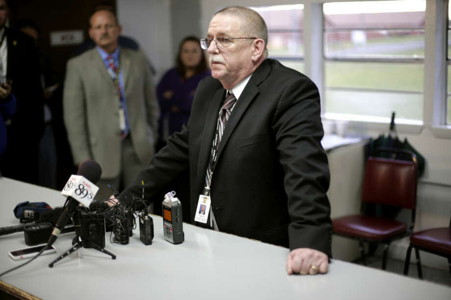 In this Tuesday, April 29, 2014 photo, Robert Patton talks with members of the media about the attempted execution of Clayton Lockett, in Tulsa, Okla. Lockett died 43 minutes after his execution began Tuesday night as Oklahoma used a new drug combination for the first time in the state. Autopsy results are pending but state prison officials say Lockett apparently suffered a massive heart attack. (AP Photo/Tulsa World, John Clanton) KOTV OUT; KJRH OUT; KTUL OUT; KOKI OUT; KQCW OUT; KDOR OUT; TULSA OUT; TULSA ONLINE OUT