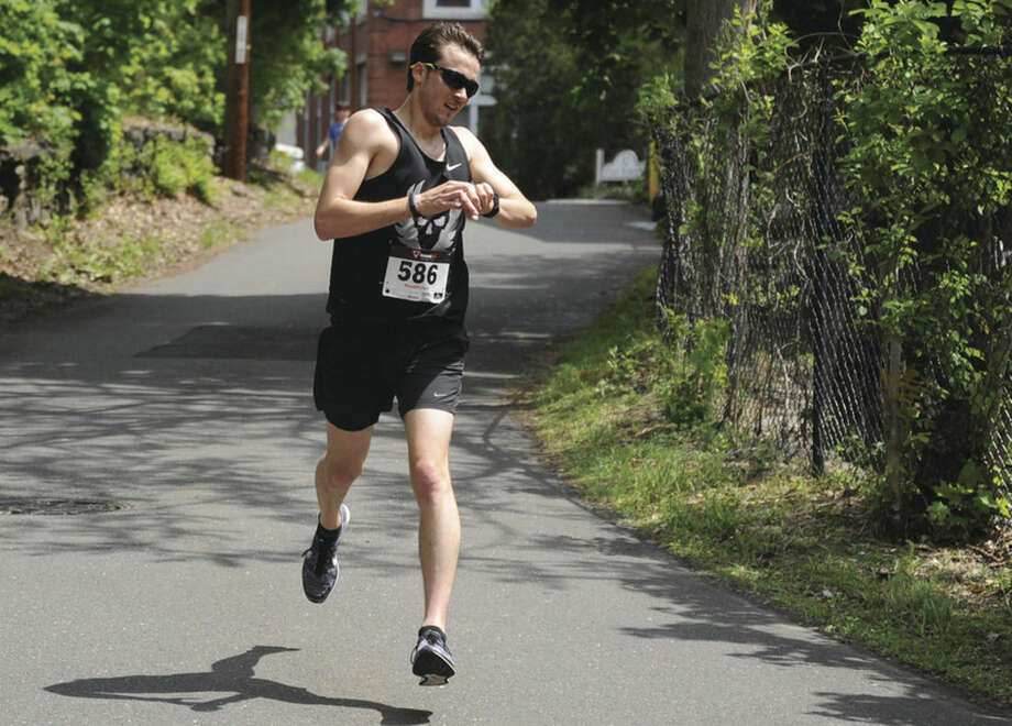 Winner Chris Nuelle with a time of 17:35 at O'Neills 5K race Sunday in Memory of Annie Curtin. hour photo/Matthew Vinci