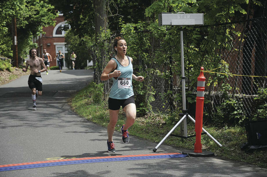 First woman across the finish line, Jessie Clifford at O'Neills 5K race Sunday in Memory of Annie Curtin. hour photo/Matthew Vinci