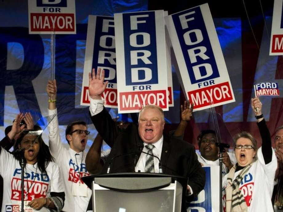 FILE - In this Thursday, April 17, 2014, file photo, Toronto mayor Rob Ford reacts as he speaks to his supporters during his campaign launch in Toronto. Rob Ford's lawyers said on Wednesday, April 30, 2014, that Ford will take a leave of absence to seek help for substance abuse. (AP Photo/The Canadian Press, Nathan Denette, File)