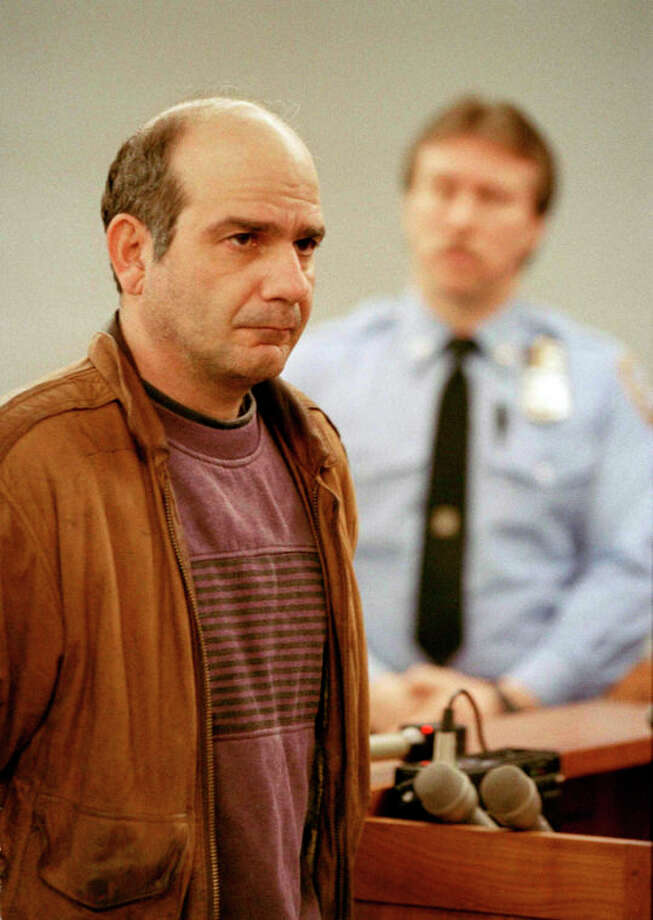 "FILE - In a Jan. 21, 1993 file photo, John Esposito faces the court during his arraignment in Central Islip, N.Y., on charges he imprisoned Katie Beers, 10, in an underground bunker. On the 20th anniversary of her ordeal, Beers has co-written a book with a television reporter who covered her kidnapping. ""Buried Memories: Katie Beers' Story"" (Title Town Publishing) has a happy ending. (AP Photo/Alex Brandon, File) / AP"