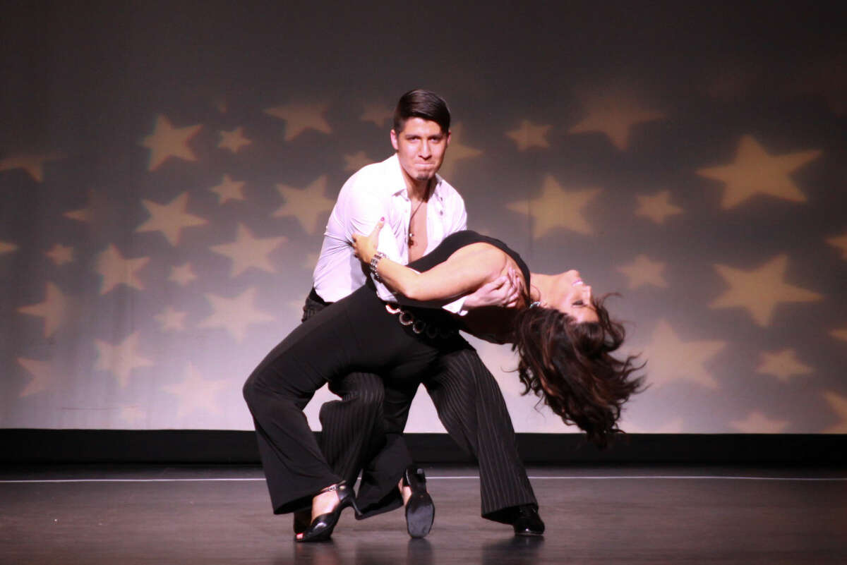 Local salon owner, Maureen Clark Newlove, seen here with her professional dance partner, Moises Guerrero, took home thePeoples' Choice Award (female division) at Curtain Call's 8th Annual Dancing with the Stars event.