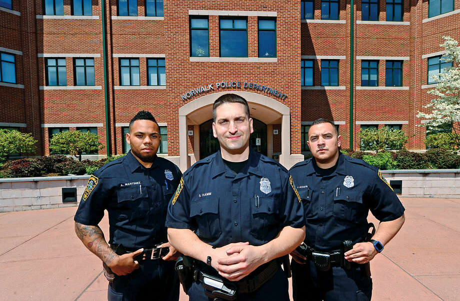 Norwalk police officers, Ariel Martinez, Brian Hamm and Jaime Acosta at Norwalk Police Headquarters Wednesday, May 11, 2016 in Norwalk, Conn. Martinez, Hamm and Acosta are officers from other Connecicut departments and are new to the Norwalk Police Department.